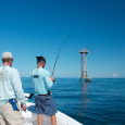 Fishing for barracudas on a tower.